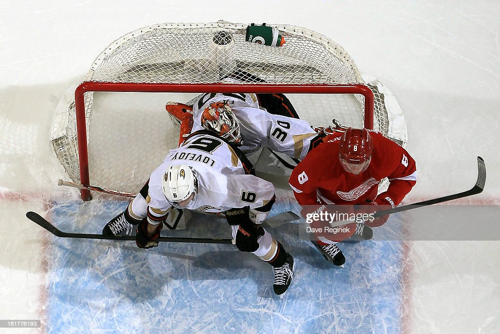 Viktor Fasth #30 of the Anaheim Ducks gets pushed back into his net by <a gi-track='captionPersonalityLinkClicked' href=/galleries/search?phrase=Justin+Abdelkader&family=editorial&specificpeople=2271858 ng-click='$event.stopPropagation()'>Justin Abdelkader</a> #8 of the Detroit Red Wings and teamate <a gi-track='captionPersonalityLinkClicked' href=/galleries/search?phrase=Ben+Lovejoy&family=editorial&specificpeople=4509565 ng-click='$event.stopPropagation()'>Ben Lovejoy</a> #6 during a NHL game on February 15, 2013 at Joe Louis Arena in Detroit, Michigan. Anaheim defeated Detroit 5-2