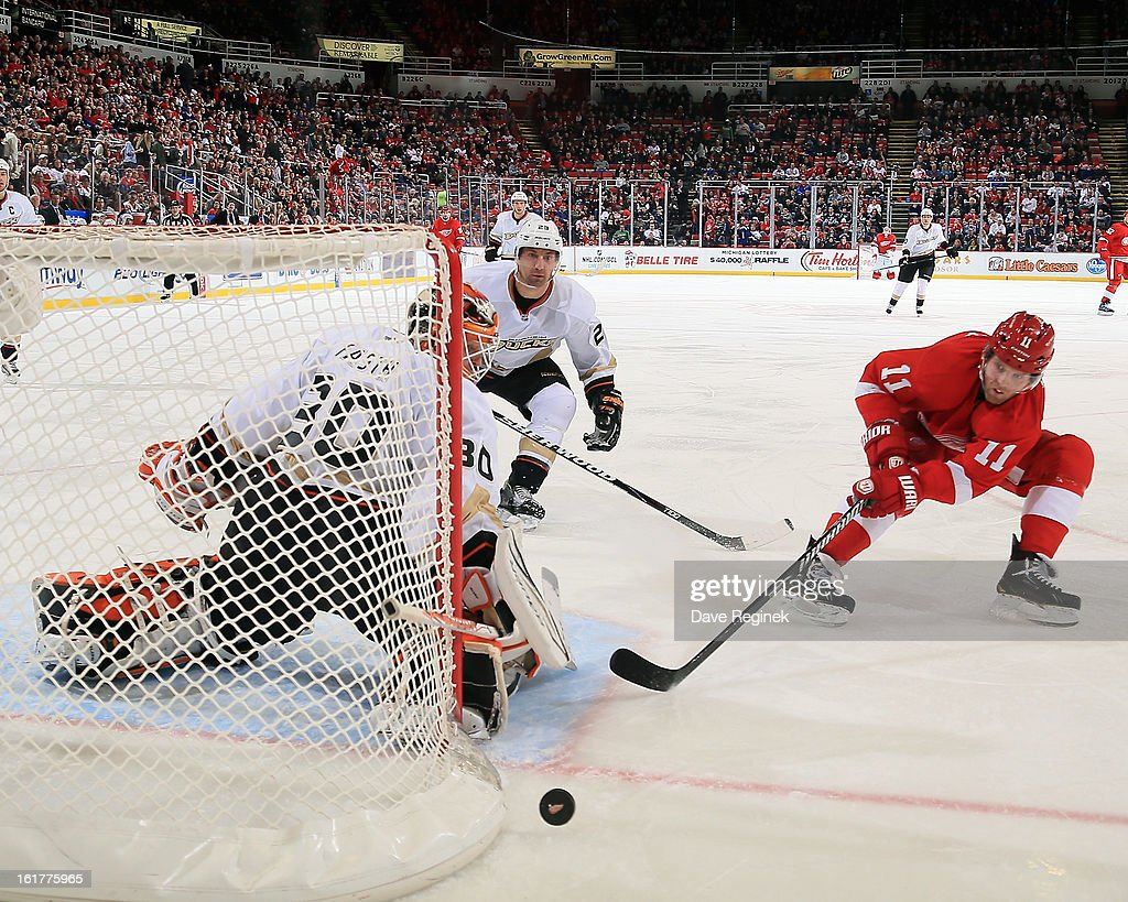 Viktor Fasth #30 of the Anaheim Ducks makes a save on Daniel Ceary #13 of the Detroit Red Wings while teamate <a gi-track='captionPersonalityLinkClicked' href=/galleries/search?phrase=Francois+Beauchemin&family=editorial&specificpeople=604125 ng-click='$event.stopPropagation()'>Francois Beauchemin</a> #23 defends during a NHL game on February 15, 2013 at Joe Louis Arena in Detroit, Michigan. Anaheim defeated Detroit 5-2