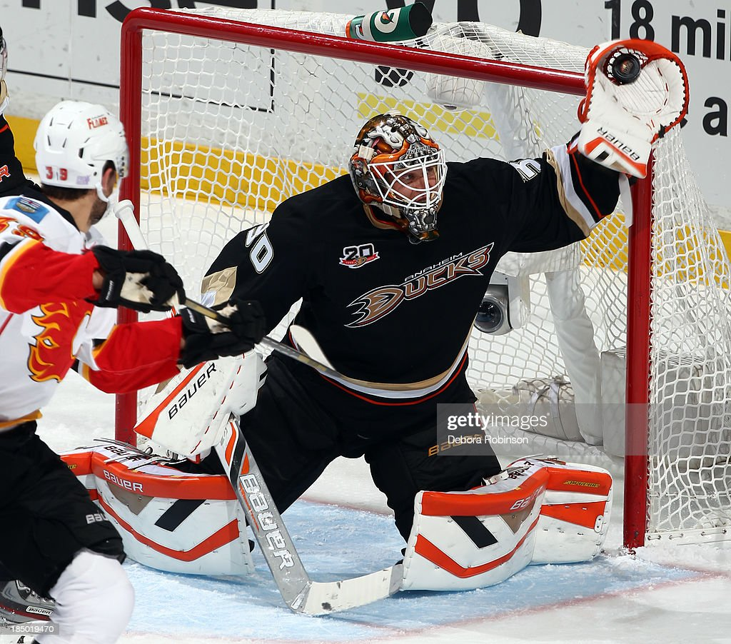<a gi-track='captionPersonalityLinkClicked' href=/galleries/search?phrase=Viktor+Fasth&family=editorial&specificpeople=7640136 ng-click='$event.stopPropagation()'>Viktor Fasth</a> #30 of the Anaheim Ducks uses the glove to stop a shot on goal by TJ Galiardi #39 of the Calgary Flames on October 16, 2013 at Honda Center in Anaheim, California.