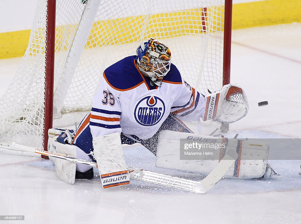 Viktor Fasth of the Edmonton Oilers blocks a shot on goal in first period action in an NHL game against the Winnipeg Jets at the MTS Centre on...