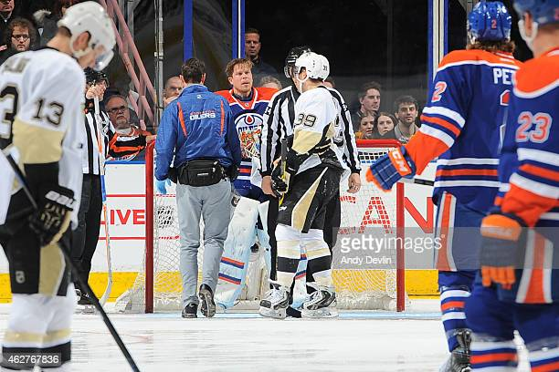 Viktor Fasth of the Edmonton Oilers exchanges words with David Perron of the Pittsburg Penguins on February 4 2015 at Rexall Place in Edmonton...