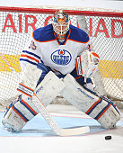 Viktor Fasth of the Edmonton Oilers faces a shot in the warmup prior to the game against the Toronto Maple Leafs during an NHL game at the Air Canada...
