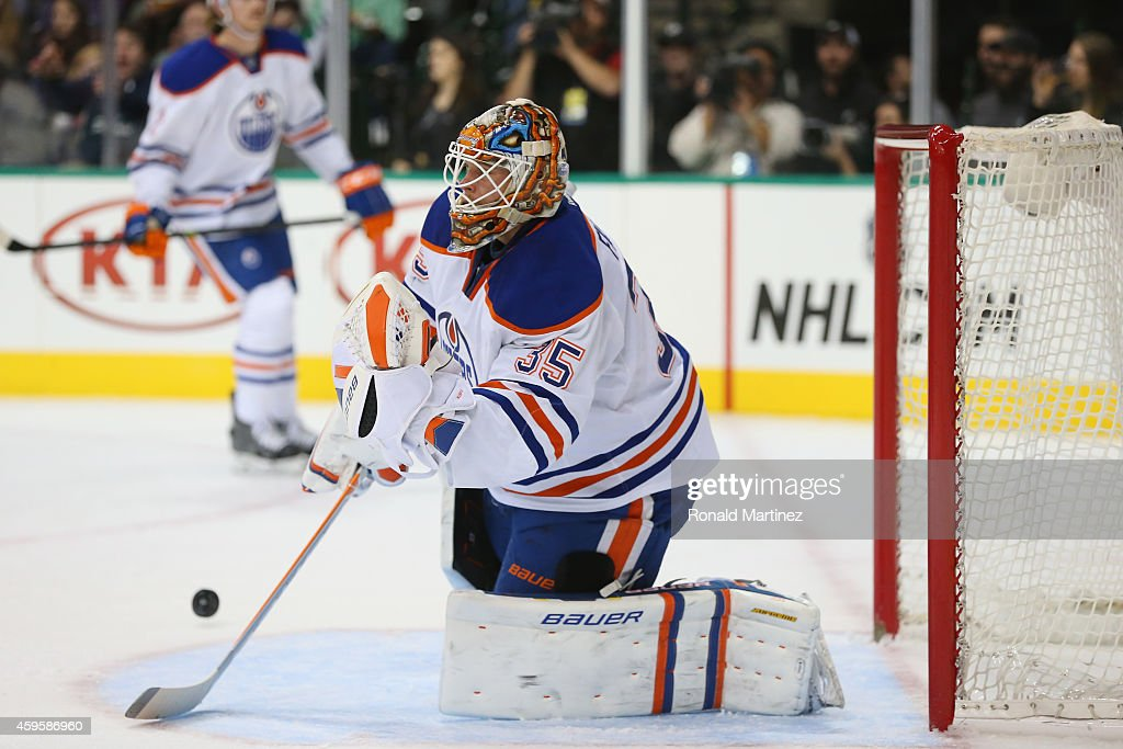 Viktor Fasth of the Edmonton Oilers gives up a goal against the Dallas Stars in the first period at American Airlines Center on November 25 2014 in...