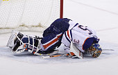 Viktor Fasth of the Edmonton Oilers lies hurt on the ice in shootout action in an NHL game against the Winnipeg Jets at the MTS Centre on February 16...