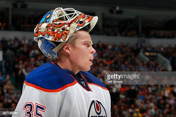 Viktor Fasth of the Edmonton Oilers looks on from the bench during their NHL game against the Vancouver Canucks at Rogers Arena October 11 2014 in...
