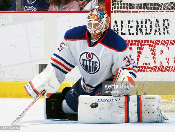 Viktor Fasth of the Edmonton Oilers makes a save during their NHL game against the Vancouver Canucks at Rogers Arena October 11 2014 in Vancouver...
