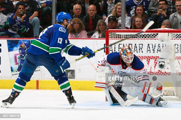 Viktor Fasth of the Edmonton Oilers makes a save off the shot of Nick Bonino of the Vancouver Canucks during their NHL game at Rogers Arena October...