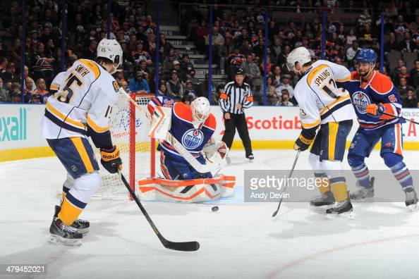 Viktor Fasth of the Edmonton Oilers makes a stop on a shot from Craig Smith of the Nashville Predators on March 18 2014 at Rexall Place in Edmonton...