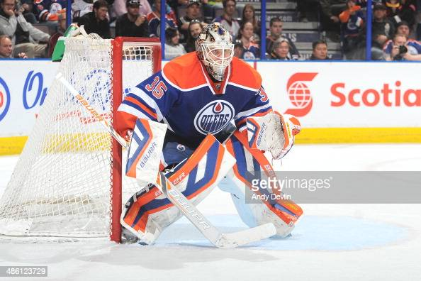 Viktor Fasth of the Edmonton Oilers prepares to make a save in a game against the Los Angeles Kings on April 10 2014 at Rexall Place in Edmonton...