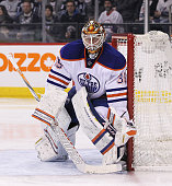 Viktor Fasth of the Edmonton Oilers protects his net in second period action in an NHL game against the Winnipeg Jets at the MTS Centre on February...