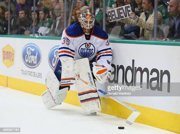 Viktor Fasth of the Edmonton Oilers skates the puck against the Dallas Stars in the first period at American Airlines Center on November 25 2014 in...