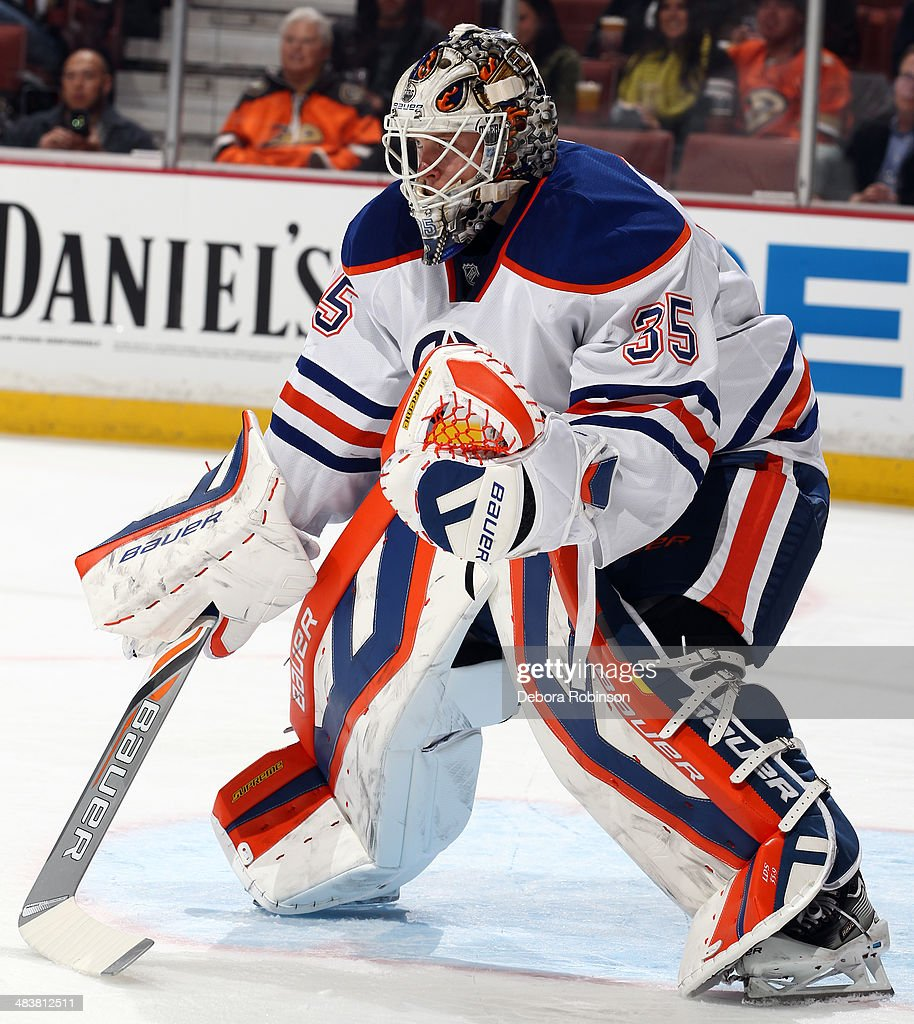 Viktor Fasth of the Edmonton Oilers stands in goal against the Anaheim Ducks on April 2 2014 at Honda Center in Anaheim California