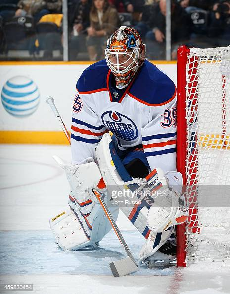 Viktor Fasth of the Edmonton Oilers tends net against the Nashville Predators at Bridgestone Arena on November 27 2014 in Nashville Tennessee