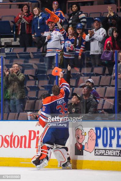 Viktor Fasth of the Edmonton Oilers throws a hat into the crowd after earning the third star after defeating the Nashville Predators during an NHL...