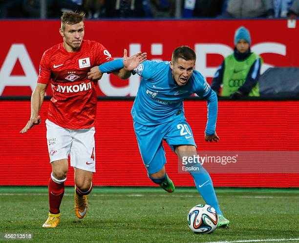 Viktor Fayzulin of FC Zenit St Petersburg and Sergei Parshivlyuk of FC Spartak Moscow vie for the ball during the Russian Football League...
