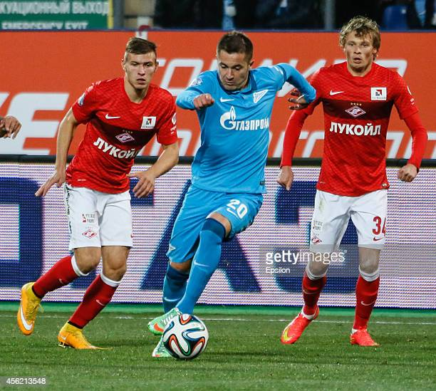 Viktor Fayzulin of FC Zenit St Petersburg vies for the ball with Sergei Parshivlyuk of FC Spartak Moscow and Yevgeni Makeyev of FC Spartak Moscow...