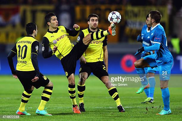 Viktor Fayzulin of Zenit is challenged by Sokratis Papastathopoulos Nuri Sahin and Henrikh Mkhitaryan of Dortmund during the UEFA Champions League...
