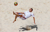 Viktor Fekete of Hungary attempts an overhead kick during the Men's beach Soccer classification 78 match between Hungary and Azerbaijan on day...