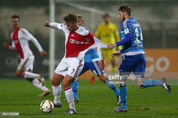Viktor Fischer 8l9 of Ajax is challenged by Aaron Hunt of Hamburg during a friendly match between Hamburger SV and Ajax Amsterdam at Gloria Sports...