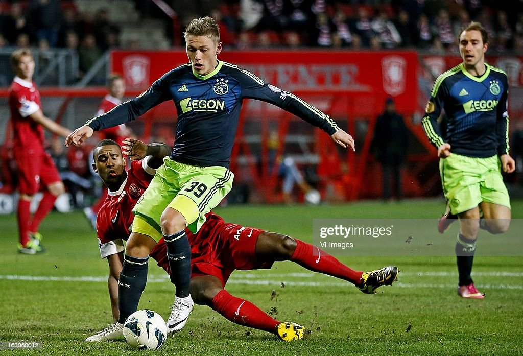 Viktor Fischer (R), Douglas (L) during the Dutch Eredivisie match between FC Twente and Ajax Amsterdam at the Grolsch Veste on march 02, 2013 in Enschede, The Netherlands