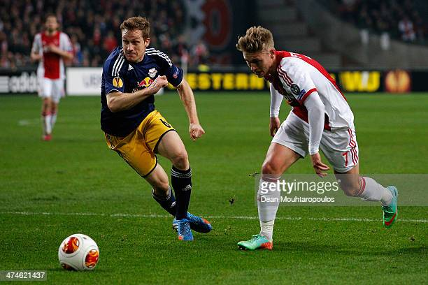 Viktor Fischer of Ajax and Christian Schwegler of Salzburg battle for the ball during the UEFA Europa League Round of 32 match between Ajax Amsterdam...