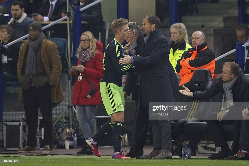 Viktor Fischer of Ajax, coach Frank de Boer of Ajax, assistant trainer Dennis Bergkamp of Ajax during the Dutch Eredivise match between Vitesse Arnhem and Ajax Amsterdam at the Gelredome on January 27, 2013 in Arnhem, The Netherlands.