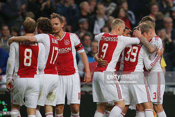 Viktor Fischer of Ajax is congratulated by team mates after he heads and scores the first goal of the game during the Eredivisie match between Ajax...