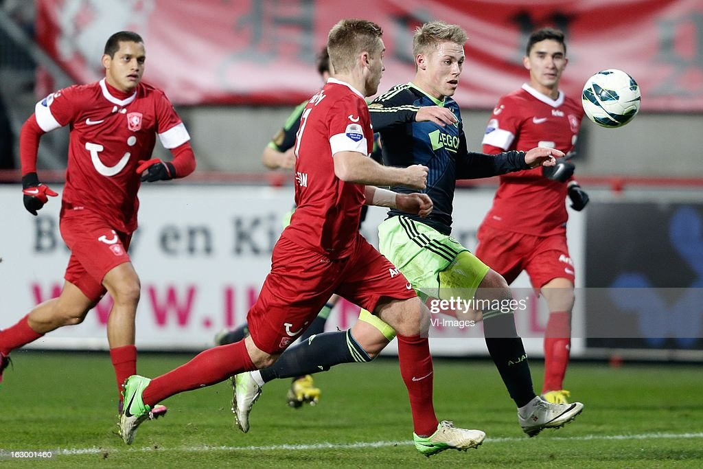Viktor Fischer of Ajax (R) Rasmus Bengtsson of FC Twente (L) during the Dutch Eredivisie match between FC Twente and Ajax Amsterdam at the Grolsch Veste on march 02, 2013 in Enschede, The Netherlands