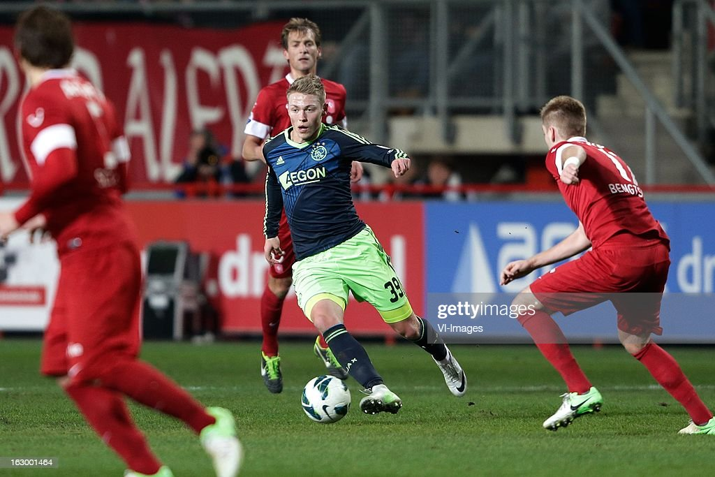 Viktor Fischer of Ajax (L) Rasmus Bengtsson of FC Twente (R) during the Dutch Eredivisie match between FC Twente and Ajax Amsterdam at the Grolsch Veste on march 02, 2013 in Enschede, The Netherlands