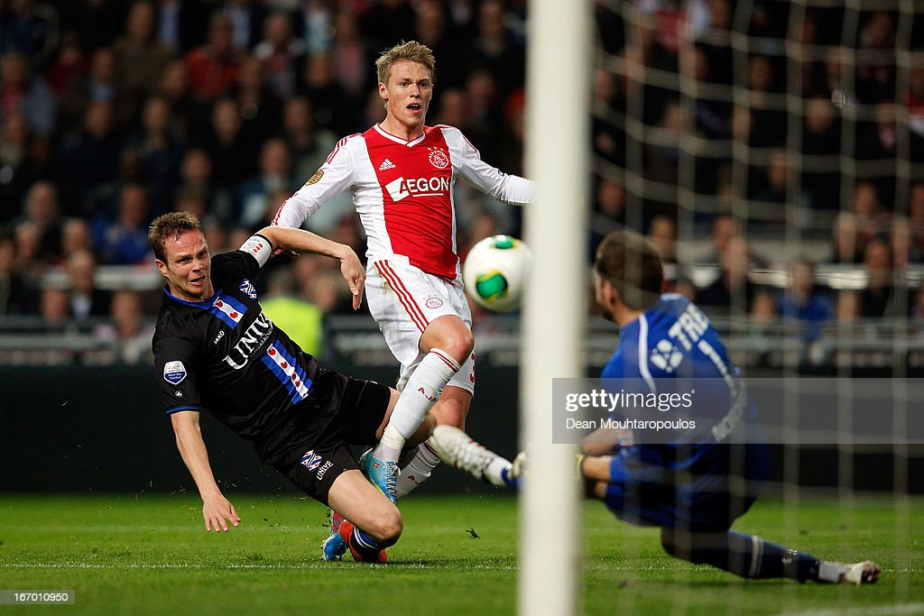 Viktor Fischer of Ajax shoots on goal as Ramon Zomer of Heerenveen tackles him and goalkeeper, Kristoffer Nordfeldt makes a save during the Eredivisie match between Ajax Amsterdam and SC Heerenveen at Amsterdam Arena on April 19, 2013 in Amsterdam, Netherlands.