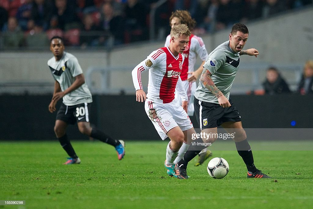 Viktor Fischer of Ajax, Theo Janssen of Vitesse during the Dutch Eredivisie match between Ajax Amsterdam and Vitesse Arnhem at the Amsterdam Arena on November 3, 2012 in Amsterdam, The Netherlands.