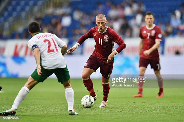 Viktor Fischer of Denmark and Svetoslav Dyakov of Bulgaria compete for the ball during the international friendly match between Denmark and Bulgaria...