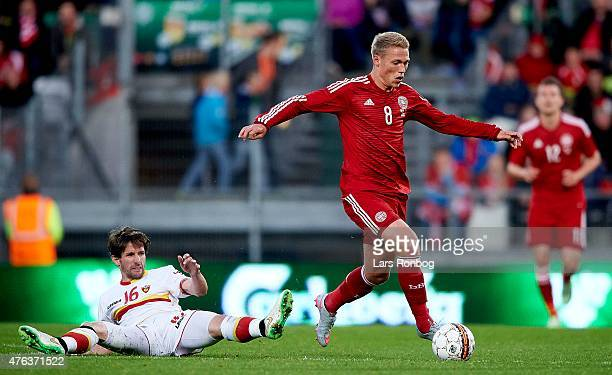 Viktor Fischer of Denmark controls the ball in front of Mladen Kascelan of Montenegro during the International Friendly match between Denmark and...