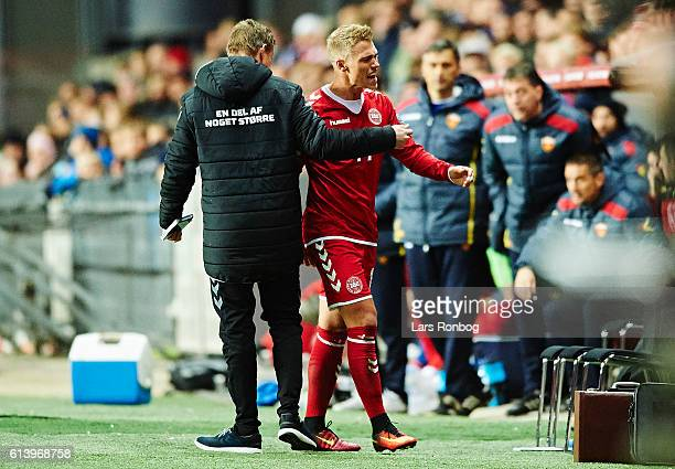 Viktor Fischer of Denmark shows frustration in front of Jon Dahl Tomasson assistant coach of Denmark during the FIFA World Cup 2018 european...