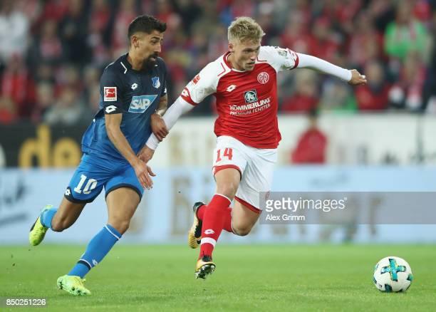 Viktor Fischer of Mainz eludes Kerem Demirbay of Hoffenheim during the Bundesliga match between 1 FSV Mainz 05 and TSG 1899 Hoffenheim at Opel Arena...