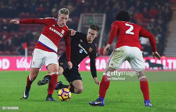 Viktor Fischer of Middlesbrough battles with Markus Henriksen of Hull City as Fabio Da Silva of Middlesbrough looks on during the Premier League...