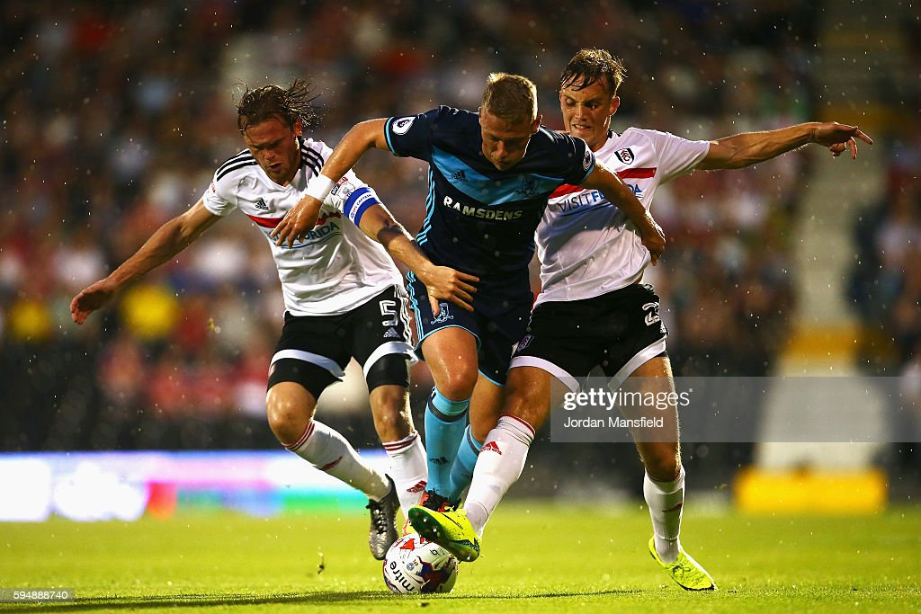 Viktor Fischer of Middlesbrough takes on Richard Stearman and Vigen Christensen of Fulham during the EFL Cup second round match between Fulham and...