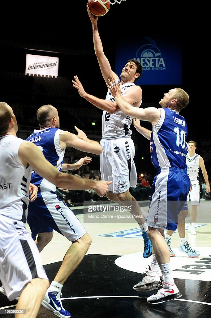 Viktor Gaddefors of Oknoplast competes with Marco Cusin #22 and Maarte Leunen # 10 of Lenovo during the LegaBasket A1 basketball match between Oknoplast Bologna and Lenovo Cantu at Unipol Arena on May 5, 2013 in Bologna, Italy.