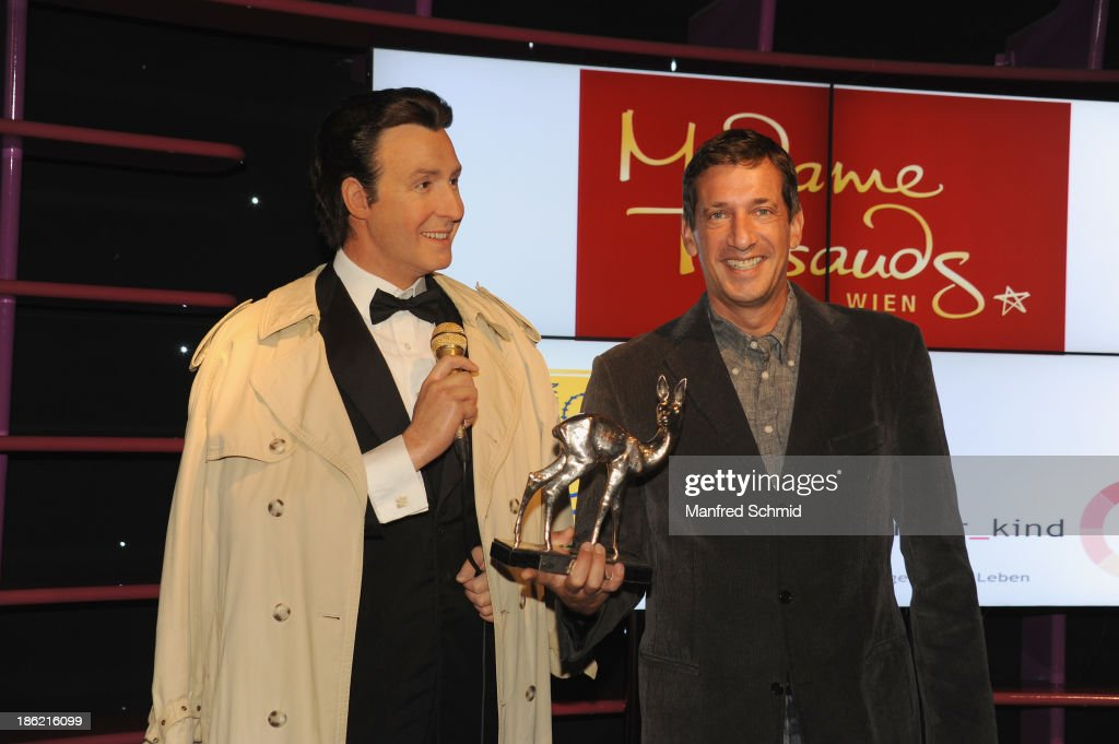 Viktor Gernot (R) poses next to a waxfigure of Peter Alexander during a press event for the Peter Alexander charity auction at Madame Tussauds on October 29, 2013 in Vienna, Austria.