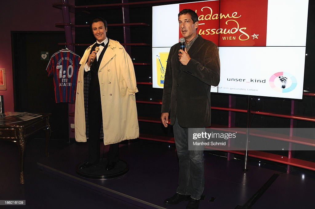 Viktor Gernot (R) speaks to the audience next to a waxfigure of Peter Alexander during a press event for the Peter Alexander charity auction at Madame Tussauds on October 29, 2013 in Vienna, Austria.