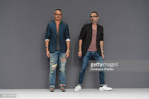 Viktor Horsting and Rolf Snoeren arrive on the runway during the Viktor Rolf Haute Couture Fall/Winter 20162017 show as part of Paris Fashion Week on...
