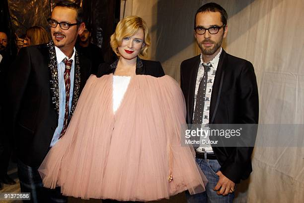 Viktor Horsting and Rolf Snoeren of Viktor Rolf pose with Roisin Murphy during the Viktor Rolf Pret a Porter show during Paris Womenswear Fashion...