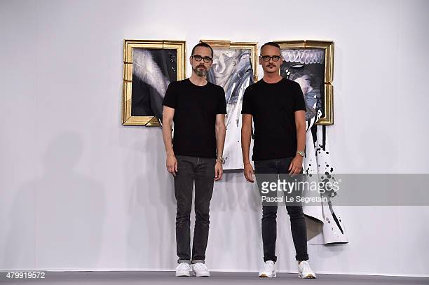 Viktor Horsting and Rolf Snoeren pose on the runway during the Viktor Rolf show as part of Paris Fashion Week Haute Couture Fall/Winter 2015/2016 on...