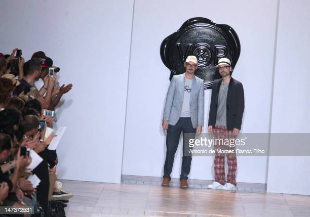 Viktor Horsting and Rolf Snoeren walk the runway at the Viktor Rolf Monsieur Monsieur Spring/Summer 2013 show as part of Paris Fashion Week at...