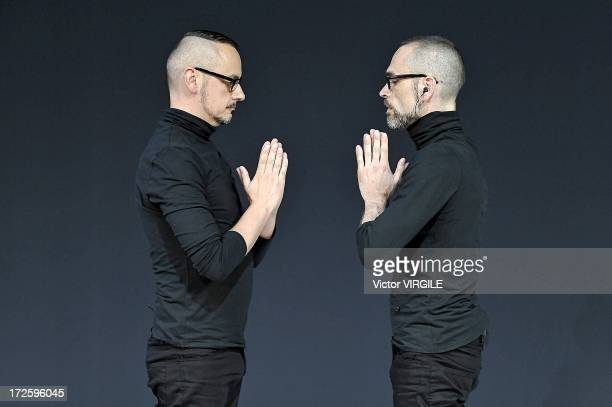 Viktor Horsting and Rolf Snoeren walk the runway during the ViktorRolf show as part of Paris Fashion Week HauteCouture Fall/Winter 20132014 on July 3...