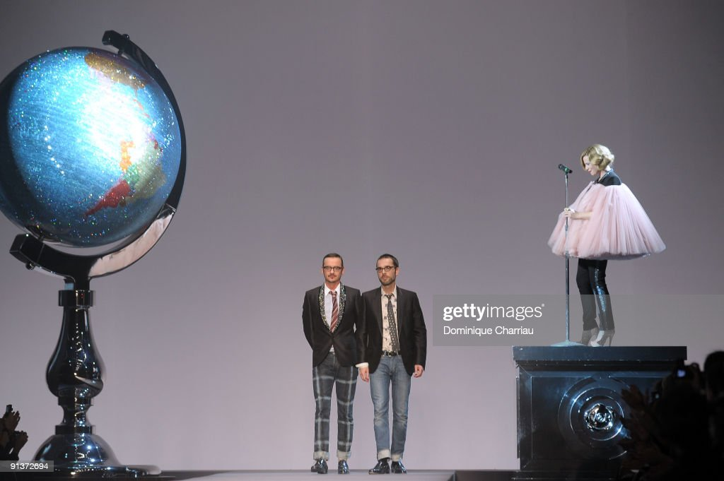 Viktor Horsting and Rolf Snoeren (L-R) walk the runway while Roisin Murphy performs during the Viktor & Rolf Spring / Summer 2010 Pret a Porter show as part of the Paris Womenswear Fashion Week at Espace Ephemere Tuileries on October 3, 2009 in Paris, France.