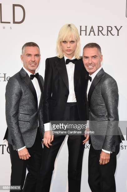 Viktor Horsting and Rolf Snoeren with Marjan Jonkman arrive at the amfAR Gala Cannes 2017 at Hotel du CapEdenRoc on May 25 2017 in Cap d'Antibes...