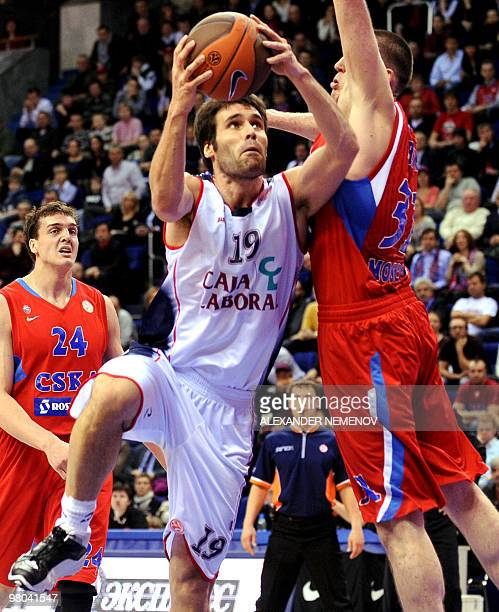 Viktor Khryapa of CSKA vies for the ball with Fernando San Emeterio of Caja Laboral during their second Euroleague quarterfinal playoff game in...