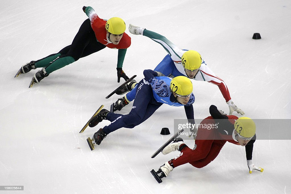 Viktor Knoch of Hungary, Semen Elistratov of Russia, Yuri Confortola of Italy, Wenhao Liang of China compete in the Men's 5000m Relay Final during the day two of the ISU World Cup Short Track at the Oriental Sports Center on December 9, 2012 in Shanghai, China.