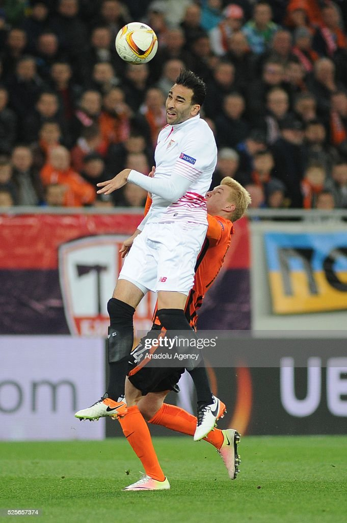 Viktor Kovalenko of Shakhtar Donetsk (R) competes for the ball with Adil Rami (L) of Sevilla FC during the UEFA Europa League Semi-finals soccer match between Shakhtar Donetsk and Sevilla FC at Lviv Arena stadium on April 28, 2016, in Lviv, Ukraine.